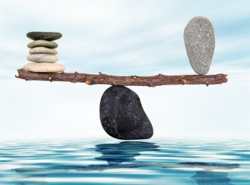 picture depicting a fulcrum with stones balanced on it to illustrate life balance