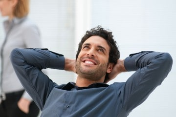 picture of happy man relaxing at office after working with a health coach