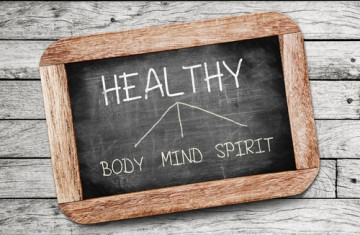 Chalkboard showing optmized health includes body, mind, spirit