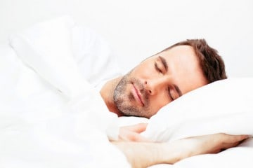 picture of a man sleeping as part of a plan from a health coach