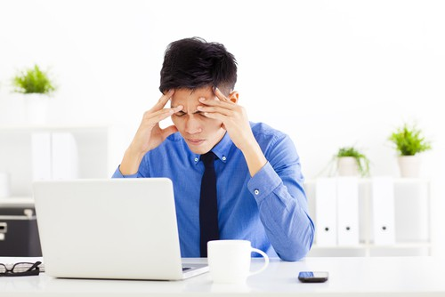 picture of a man in front of an office computer, needing a flexible home based business.