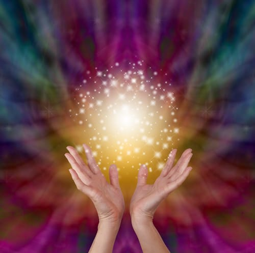 picture of hands holding ball of golden light depicting energy healing changes