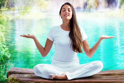 picture of a woman doing meditation from her health coach plan