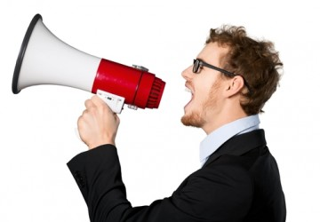 picture of a man shouting through megaphone creating stress and trapped emotions which the emotion code can release.