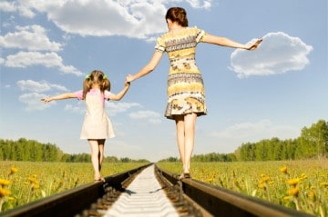 picture of mom and little girl walking the tracks showing what a health coach can do to help you lhave energy and choice at any age
